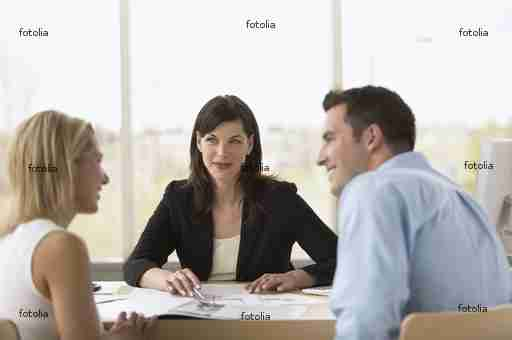 Consultant talking with a couple in her office